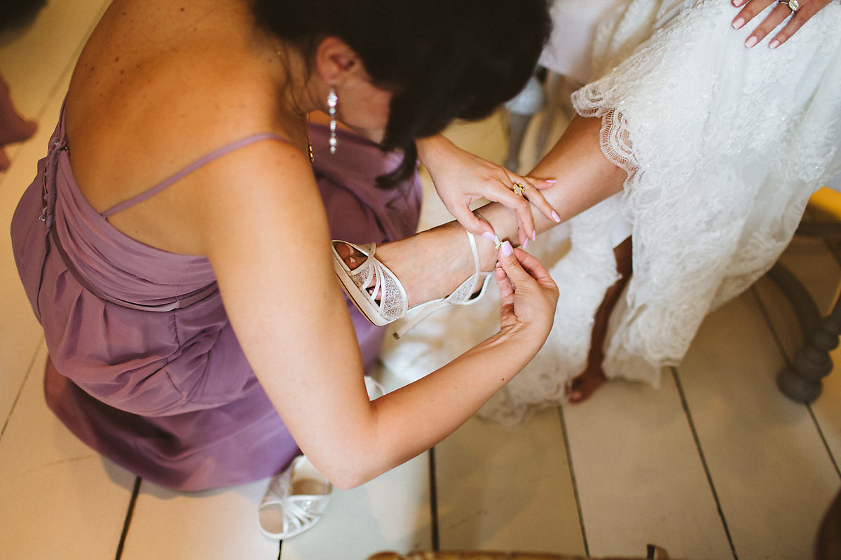 Bride getting shoes on photo