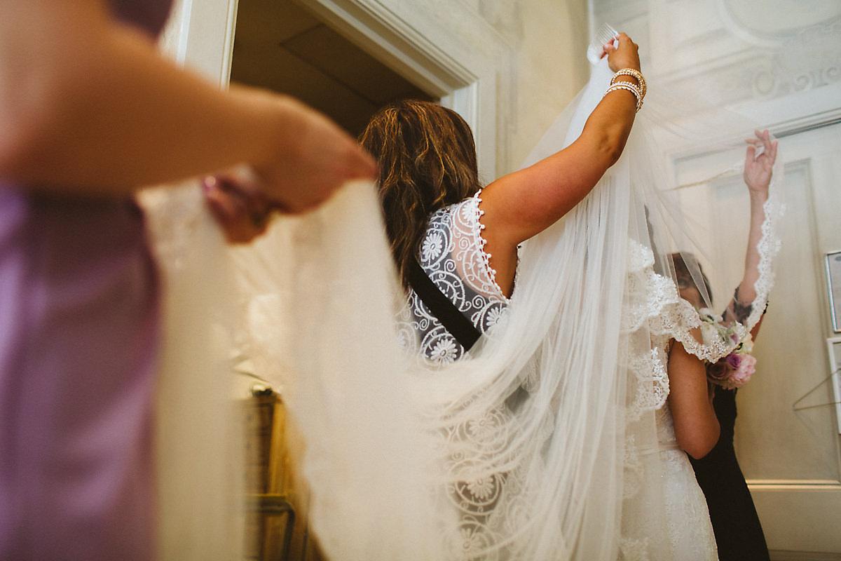 Bride getting veil ready Blakes Hotel