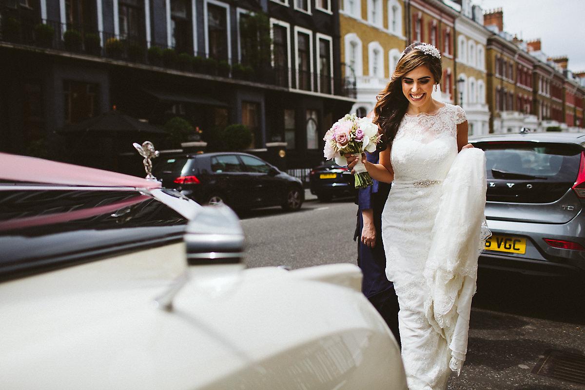 Bride getting in the car Roland Gardens