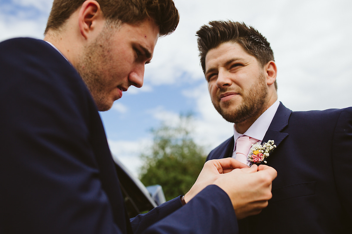 Groom buttonhole fixing