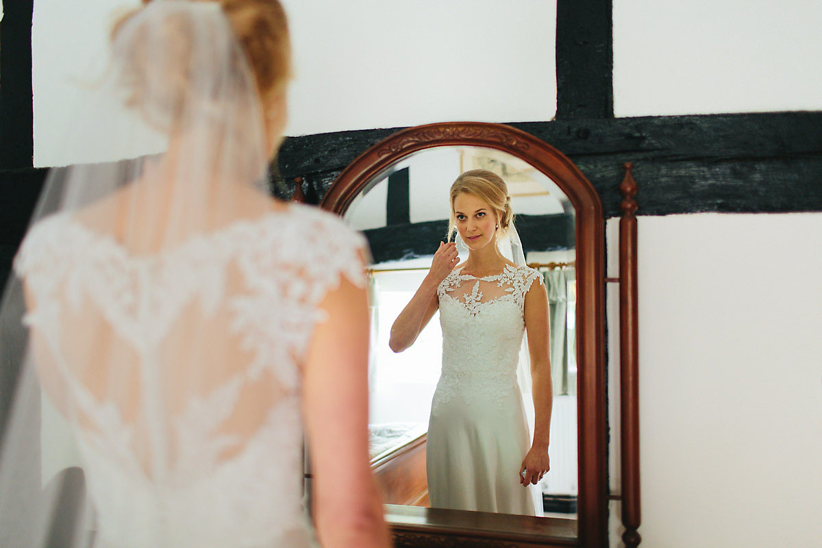 Bride looking at the mirror before ceremony