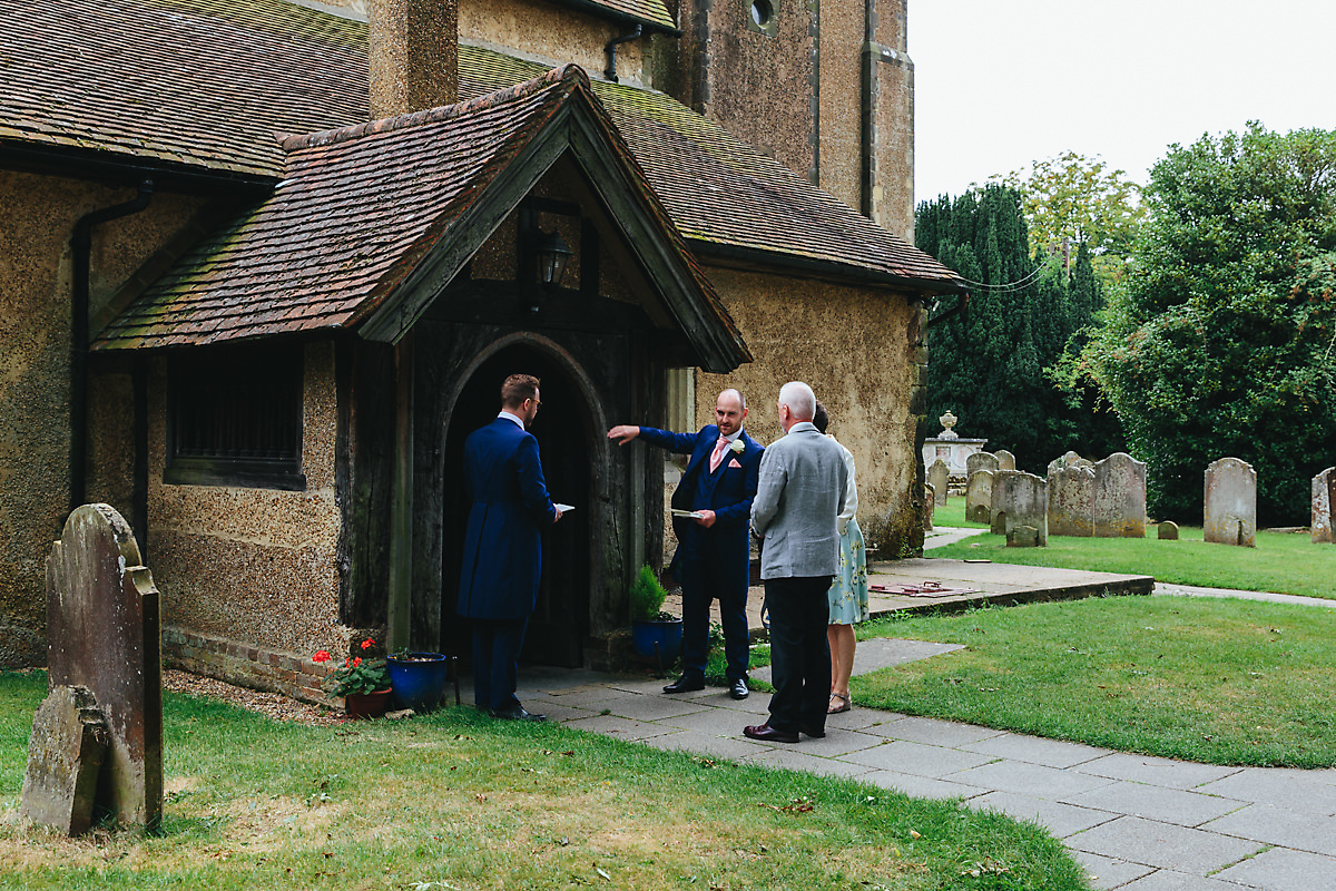 Wedding guests arriving at a Sussex church