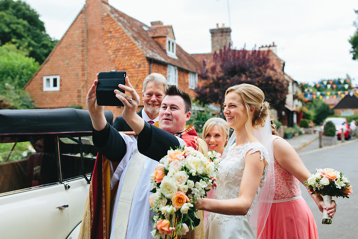 Vicar taking a selfie with the bridal party