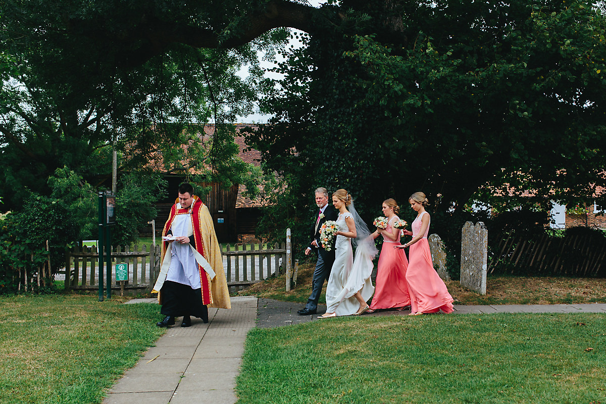 Bride walking behind the vicar