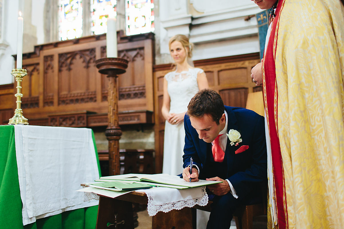 Groom signing the book