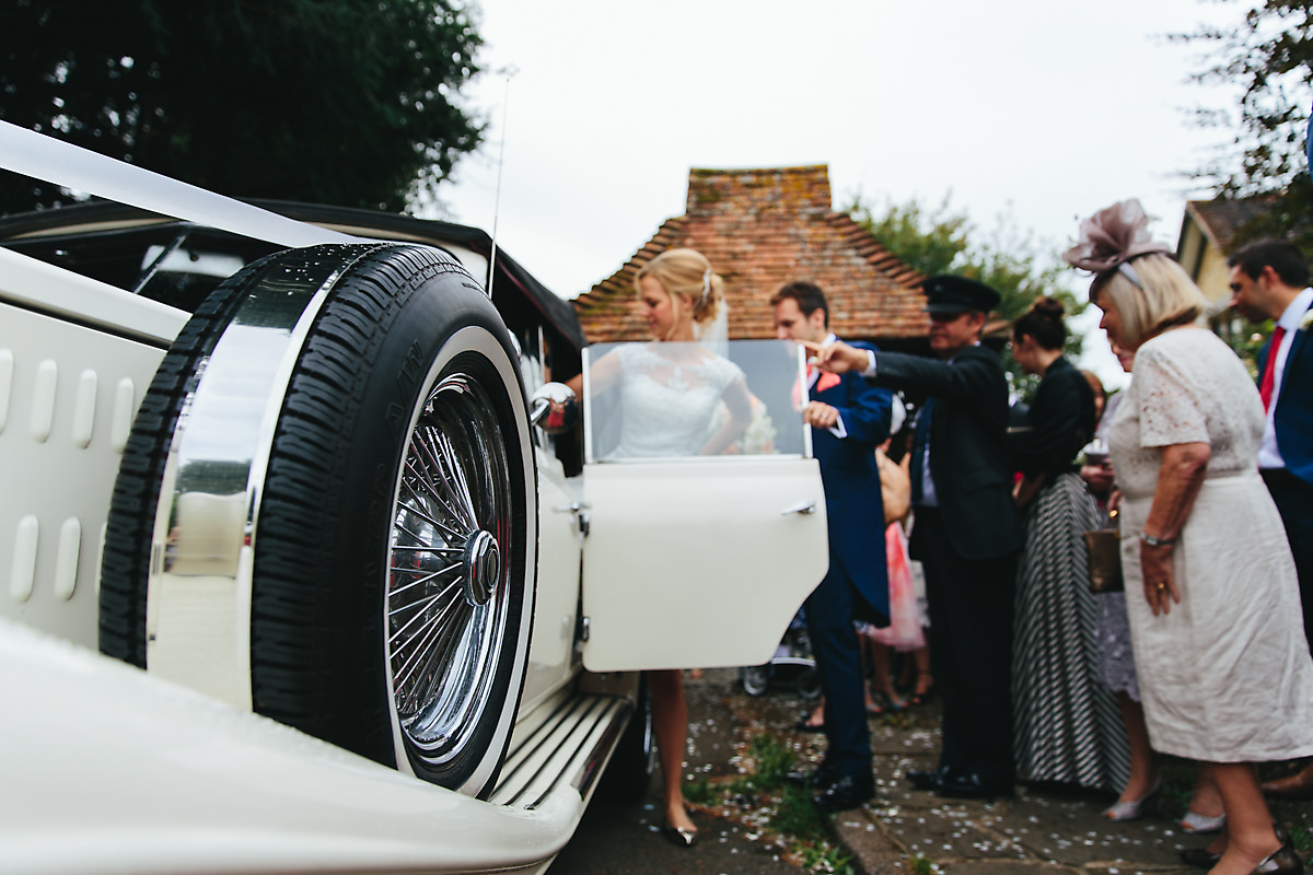 Bride and groom getting in the vintage car