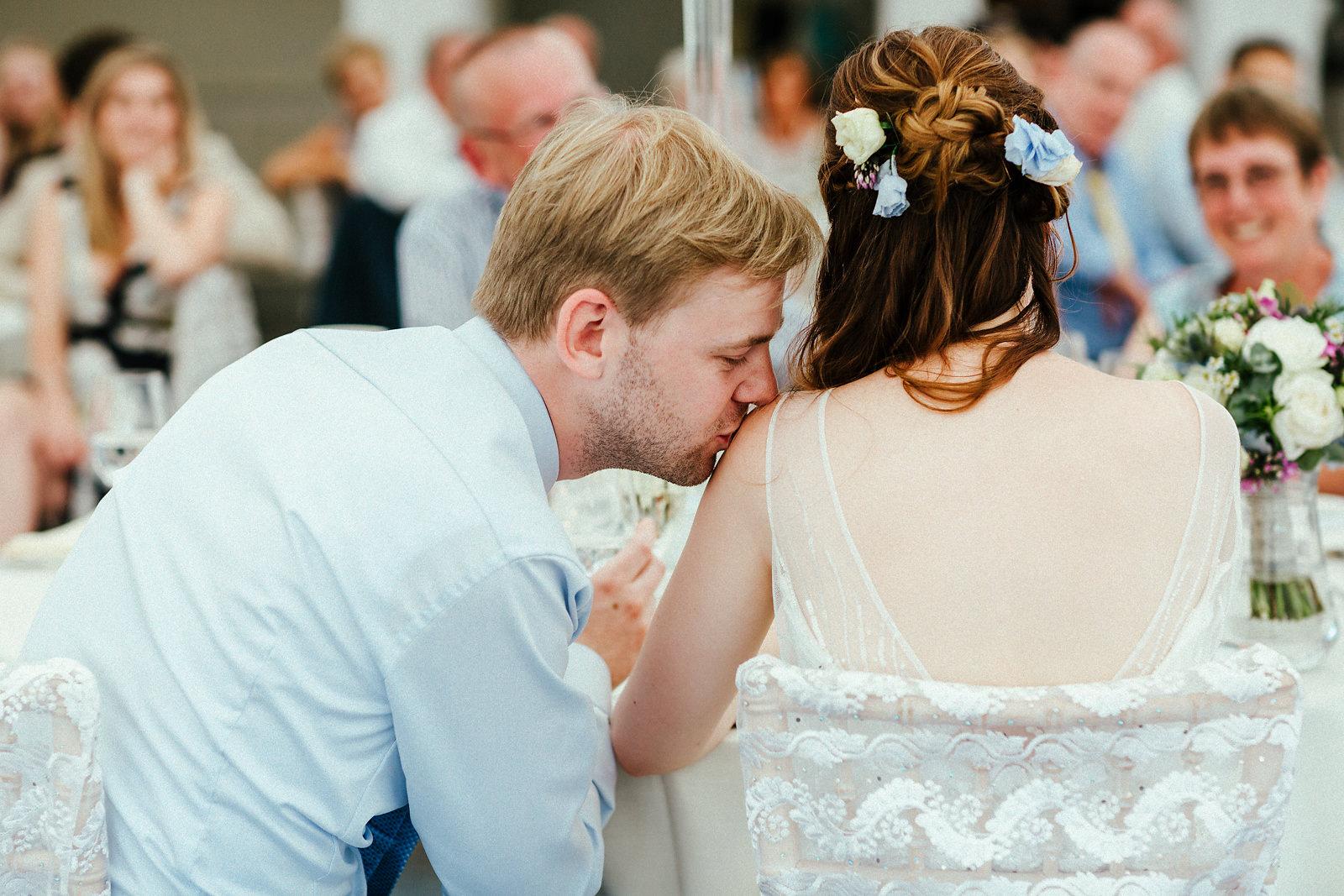 Happy groom kissing the bride
