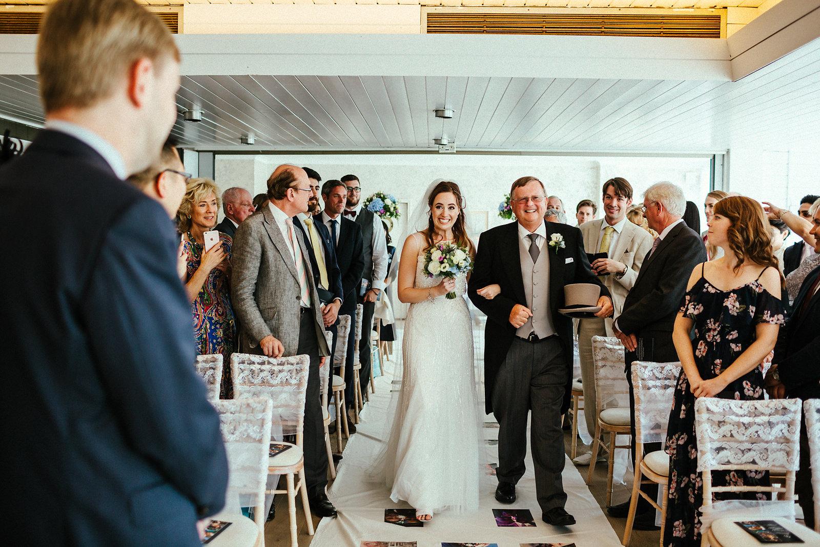 Bride walking down the aisle in Surbiton
