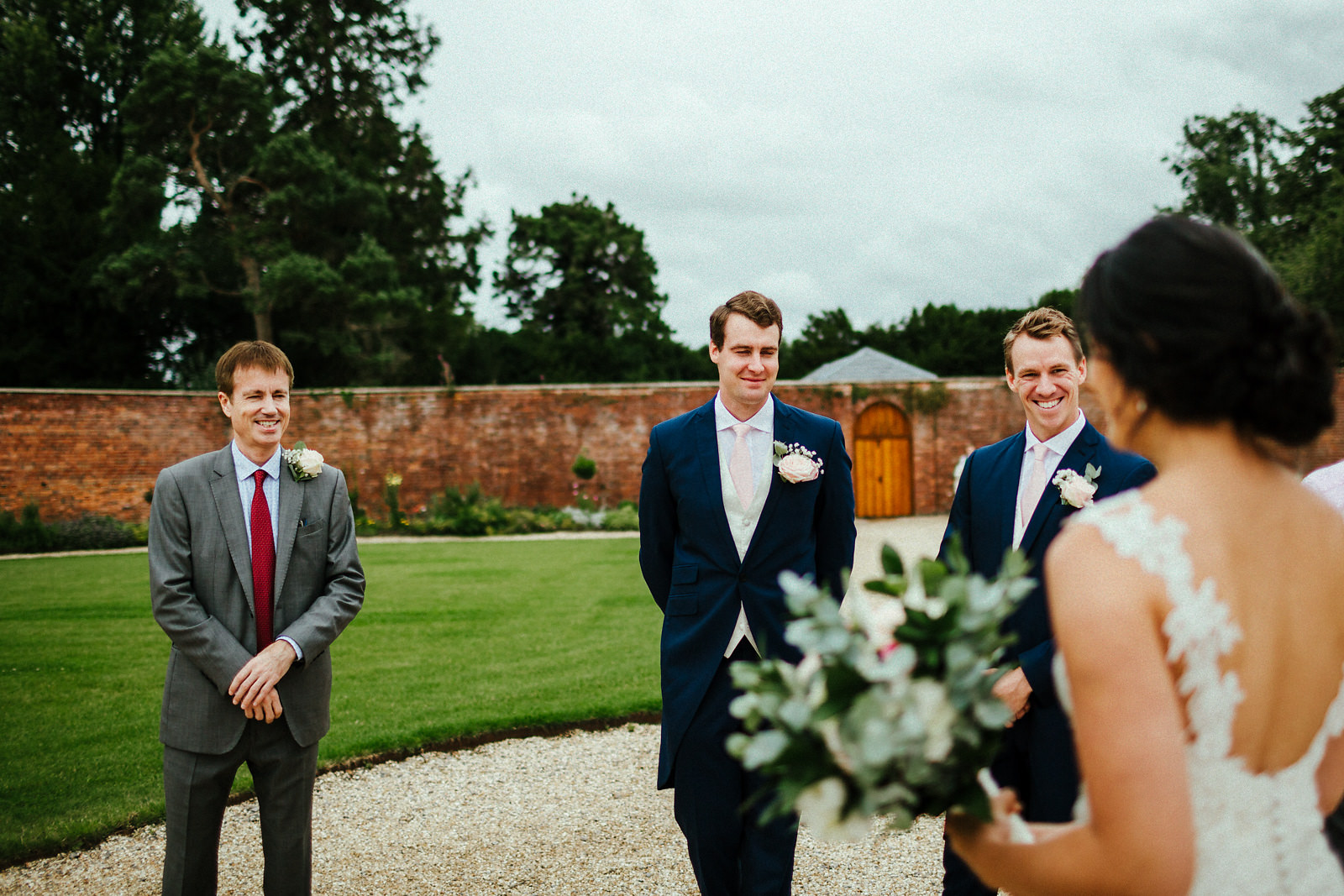 Bride meeting dad at Orchardleigh walled garden
