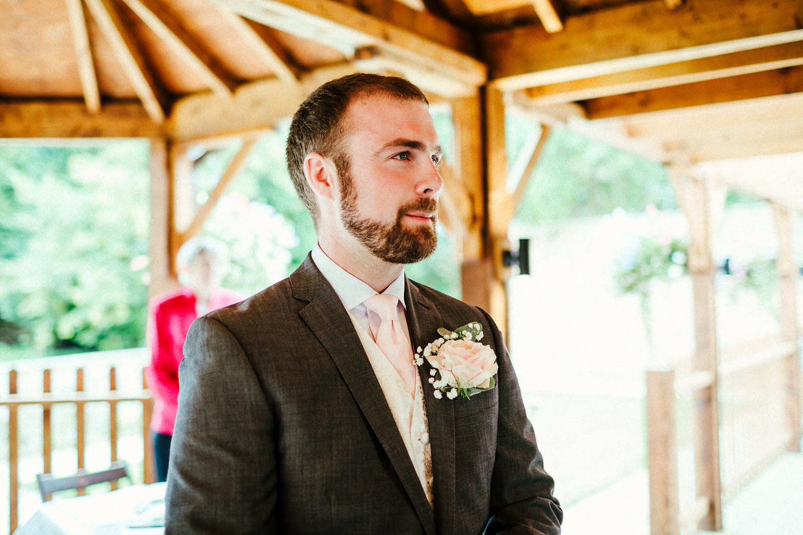 Groom waiting at Orchardleigh walled garden
