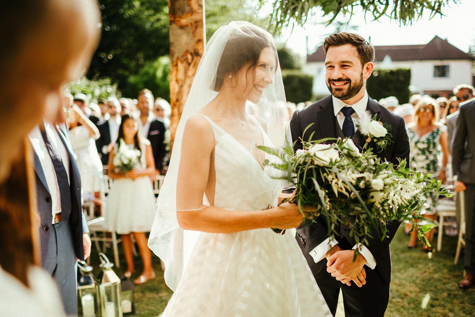 Arrival of jewish bride in August wedding