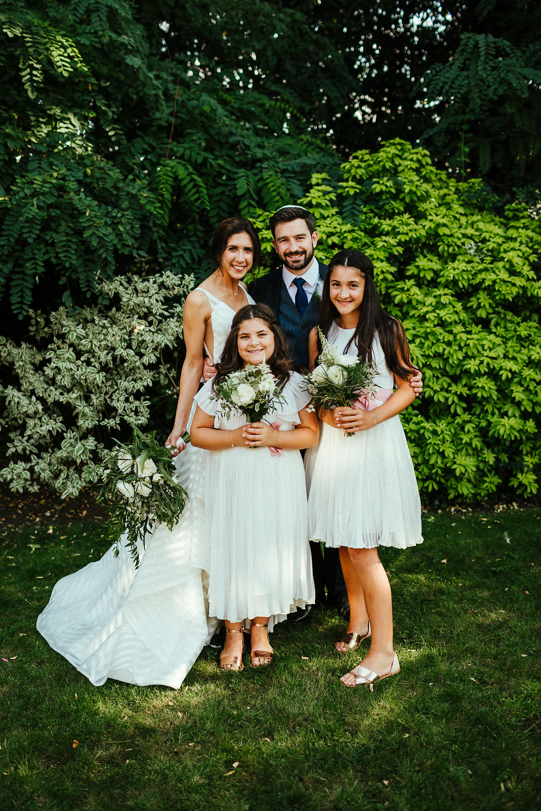 White flower girl dresses with bride and groom