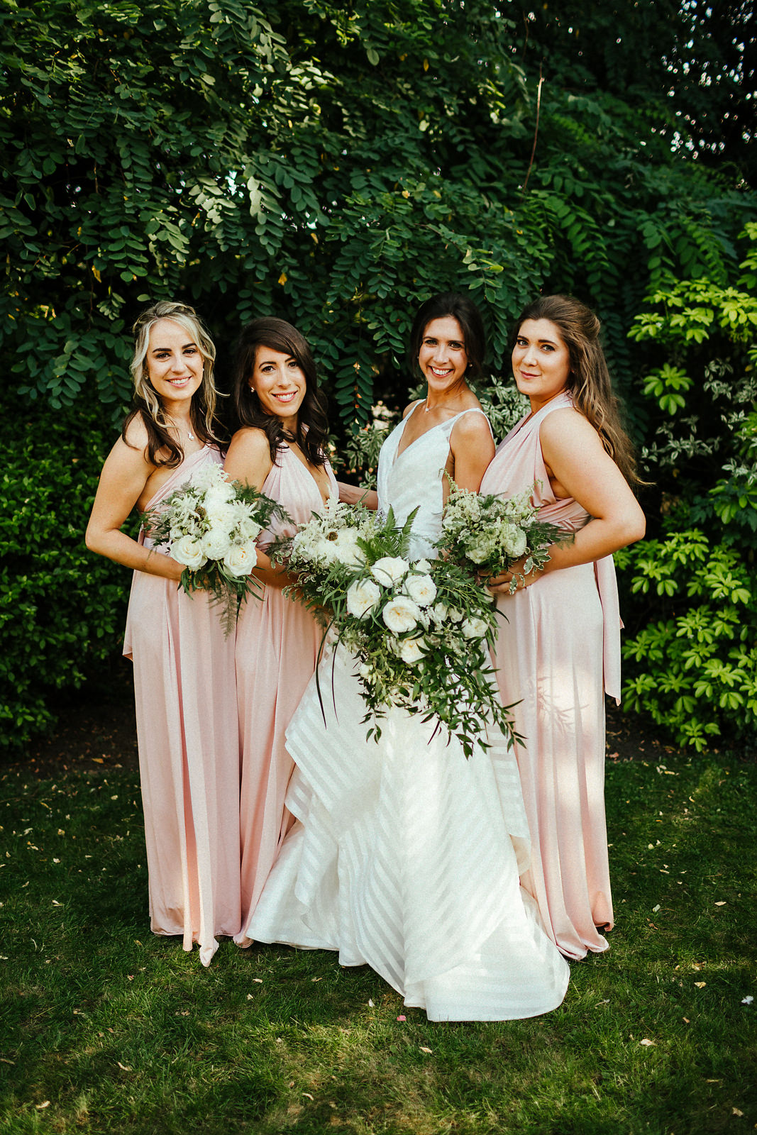 Stunning bridesmaids in pink dresses