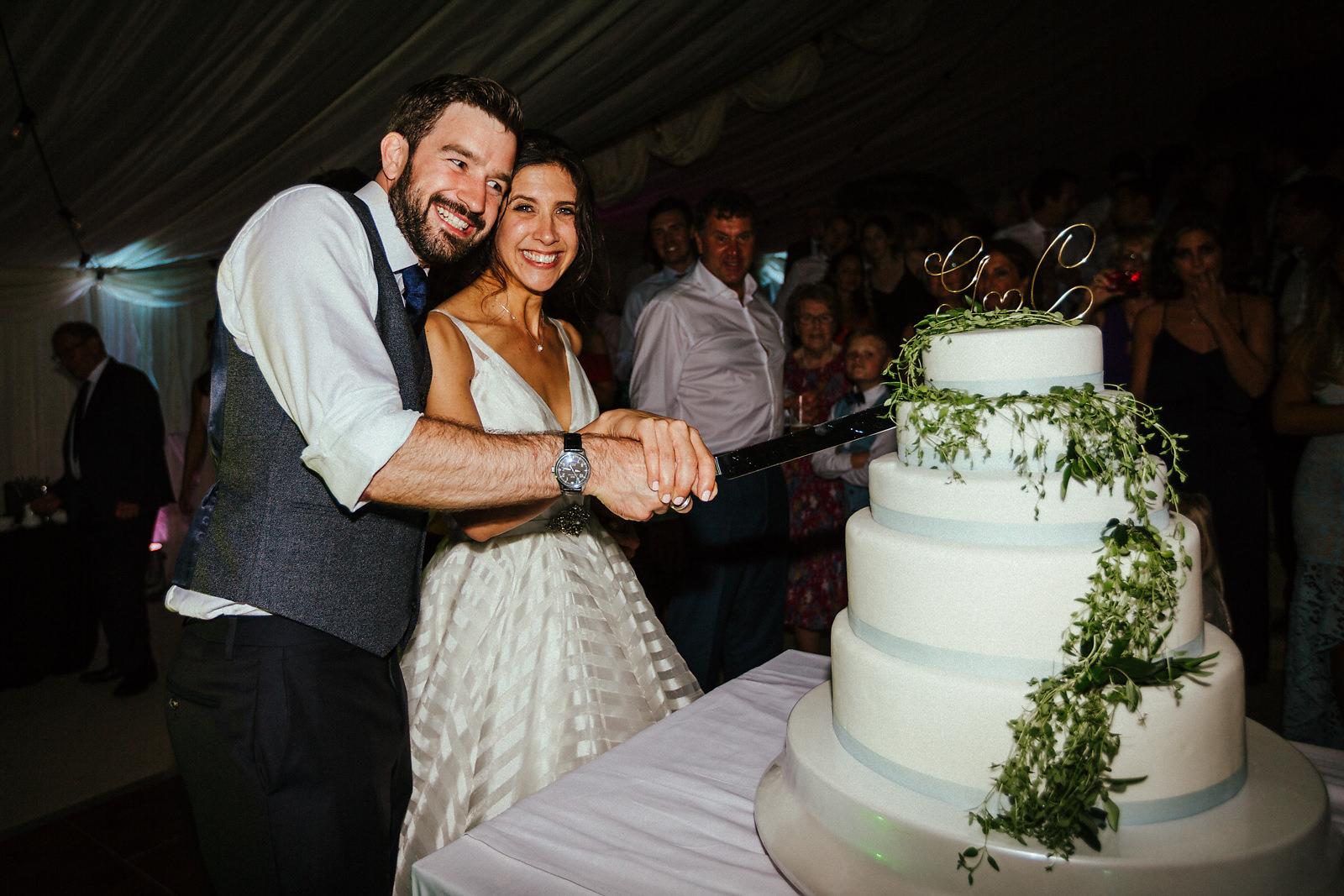 Cake cutting at Jewish wedding in Essex