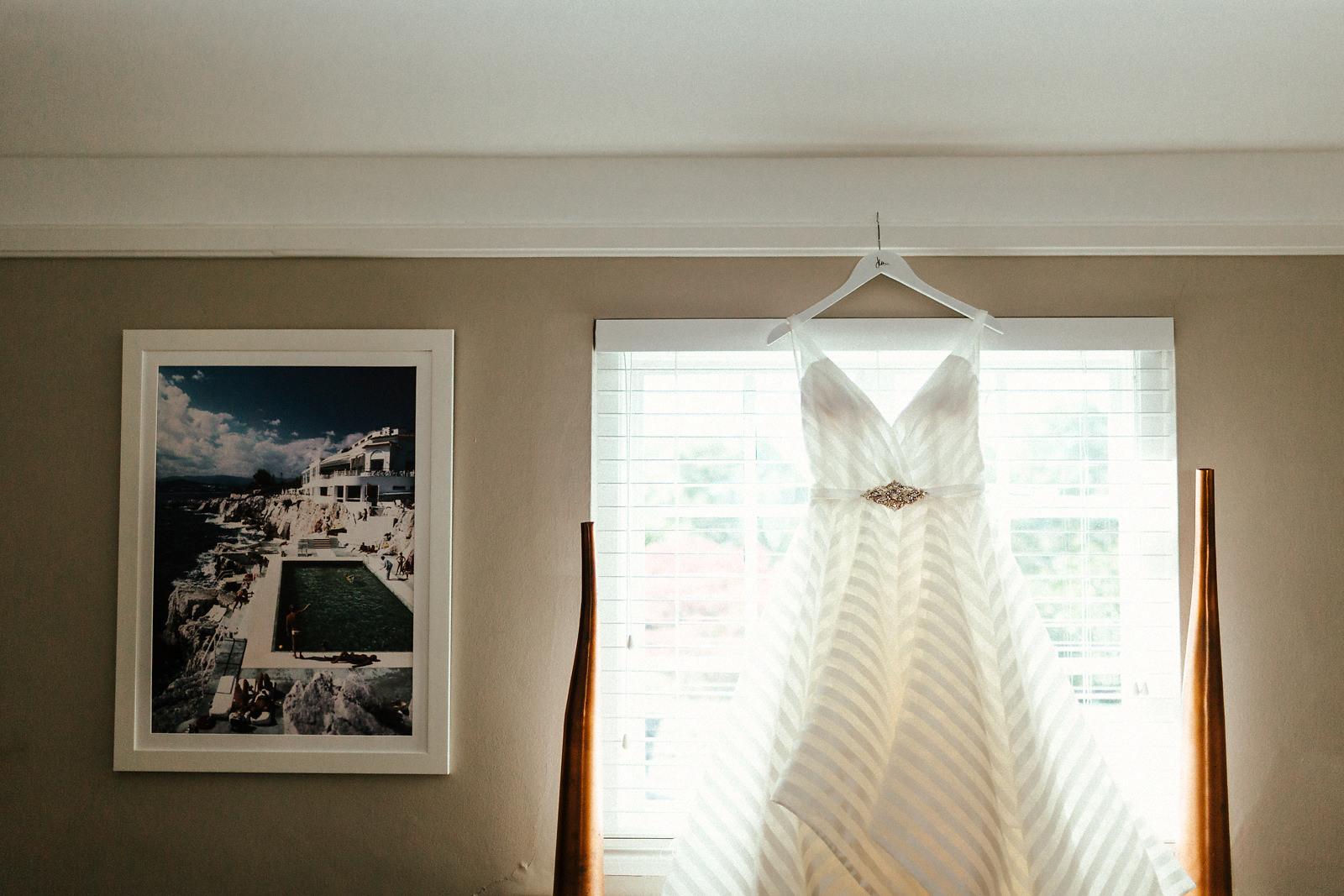 White sleeveless stripy wedding dress