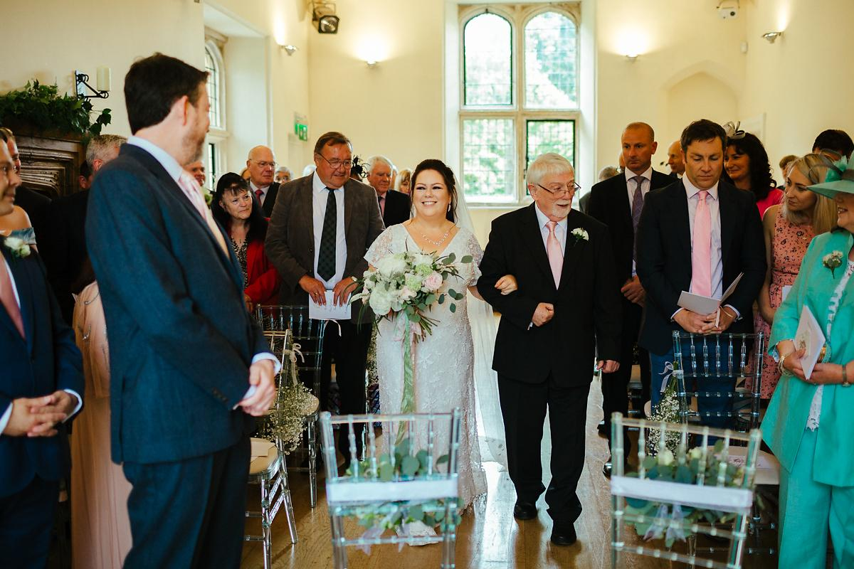 Bride walking down the aisle at Notely Abbey