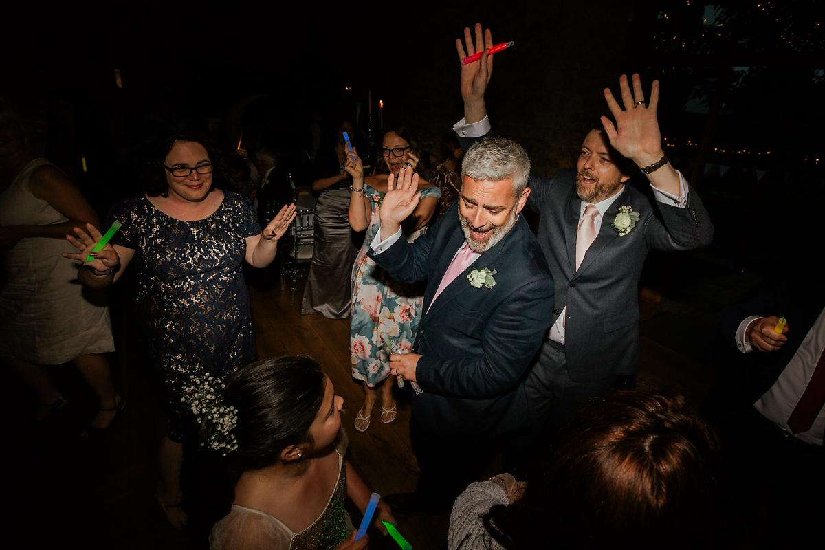 Notley Abbey wedding party in the barn