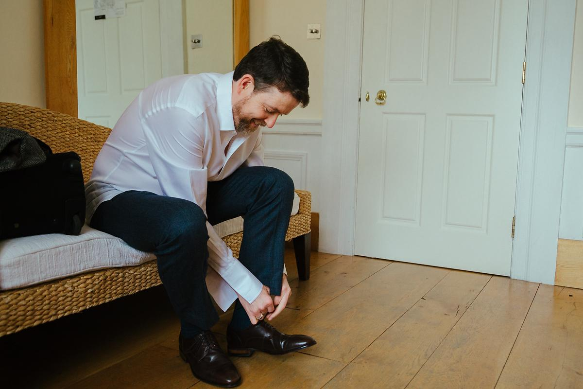 Groom getting ready at Notley Abbey photos