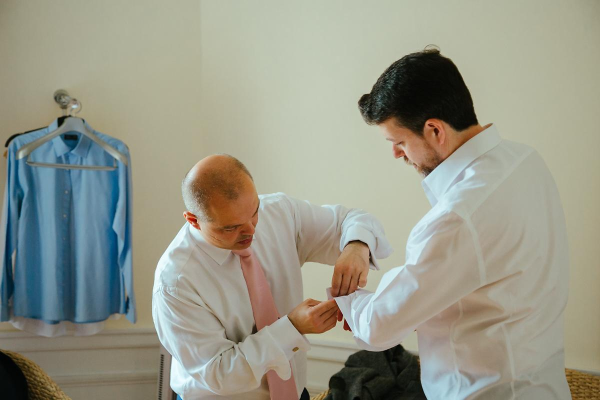 Groom getting ready at Notley Abbey