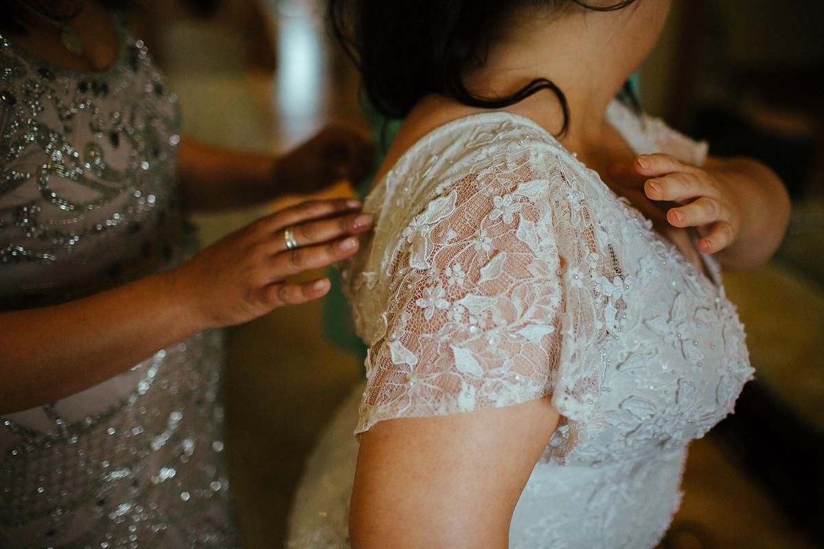 Bride getting dressed at Notley Abbey