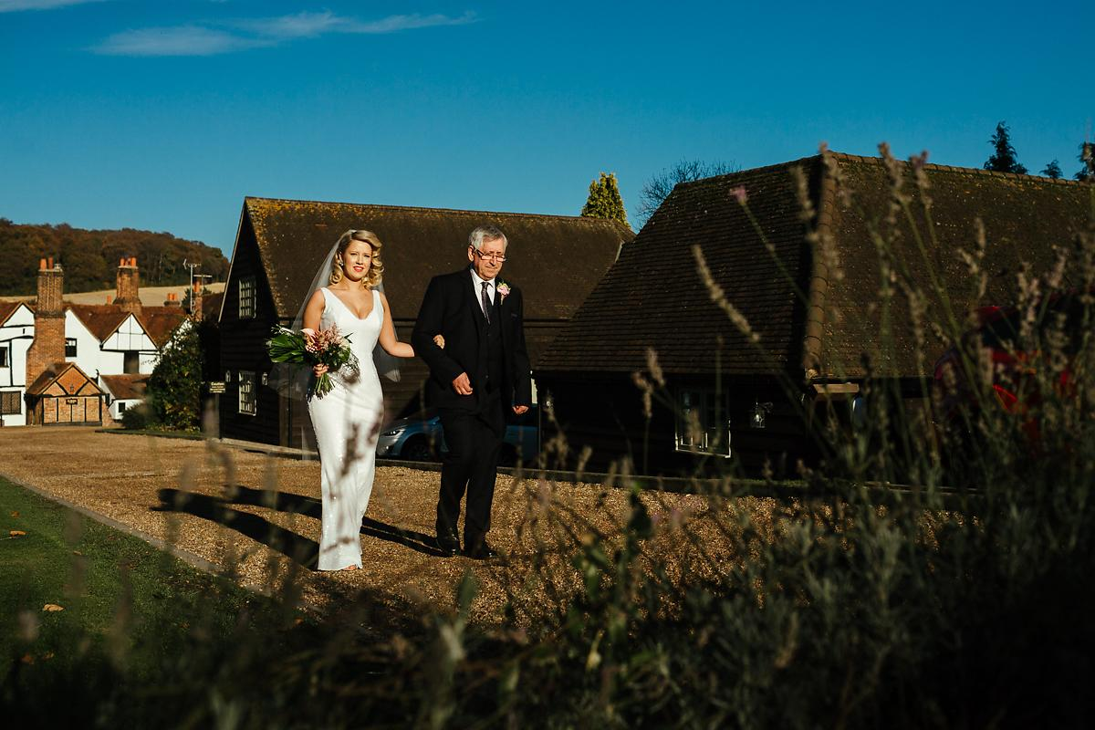 Bride and dad walking up to Kings Chapel