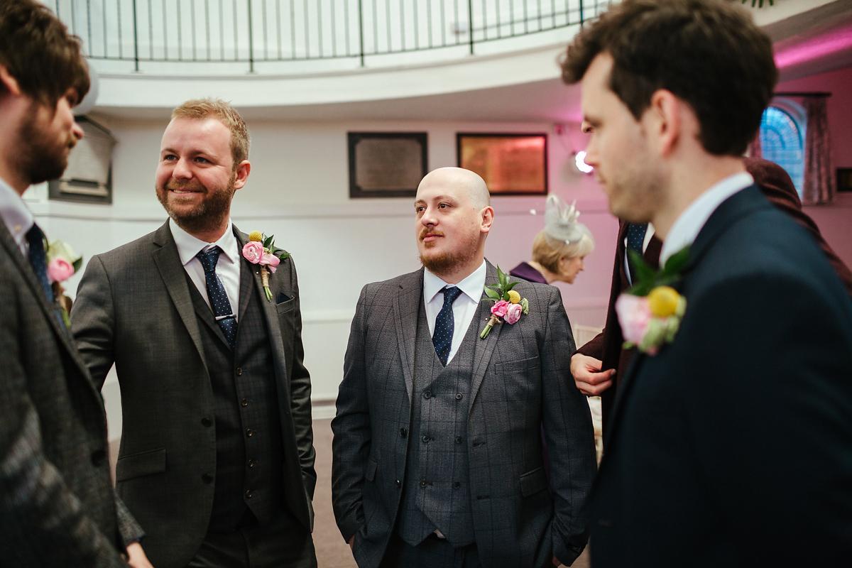 Groomsmen giving last top tips to groom