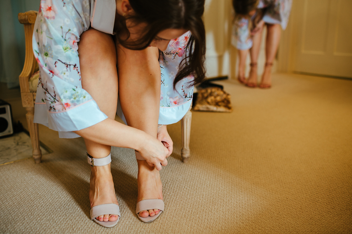 Bridesmaids getting ready in high heels.