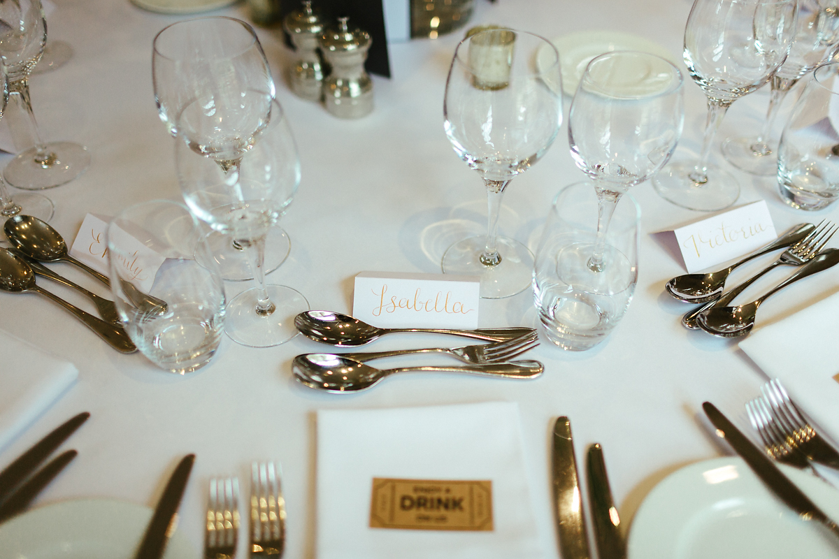 White and gold wedding table decorations Slaughters Manor House