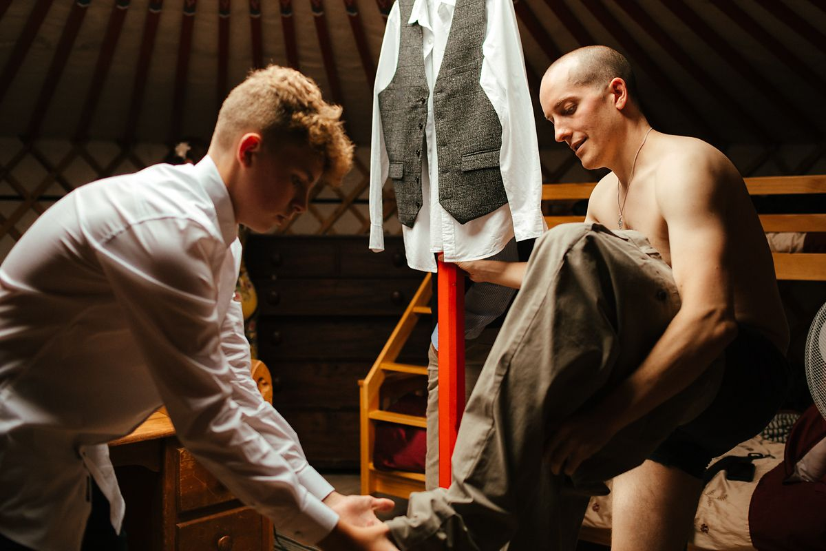 Groom getting ready in glamping style wedding