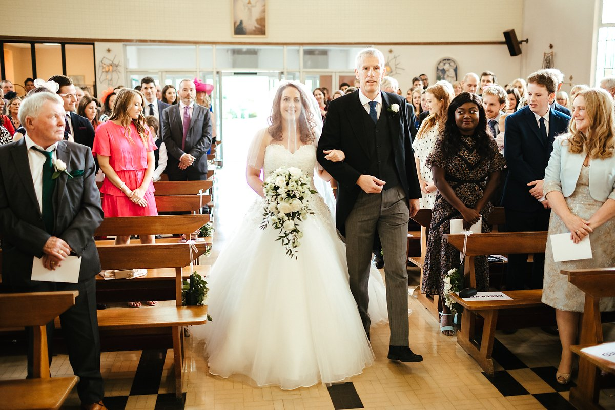 Arrival of the bride at Catholic Church wedding ceremony