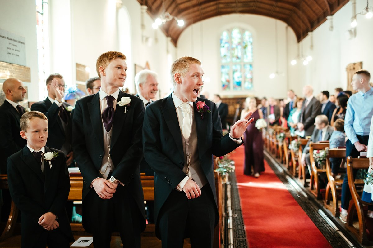 Groom wedding photography at Latimer Estate church