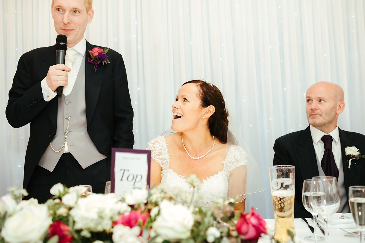 Surprised bride during speeches at Latimer House