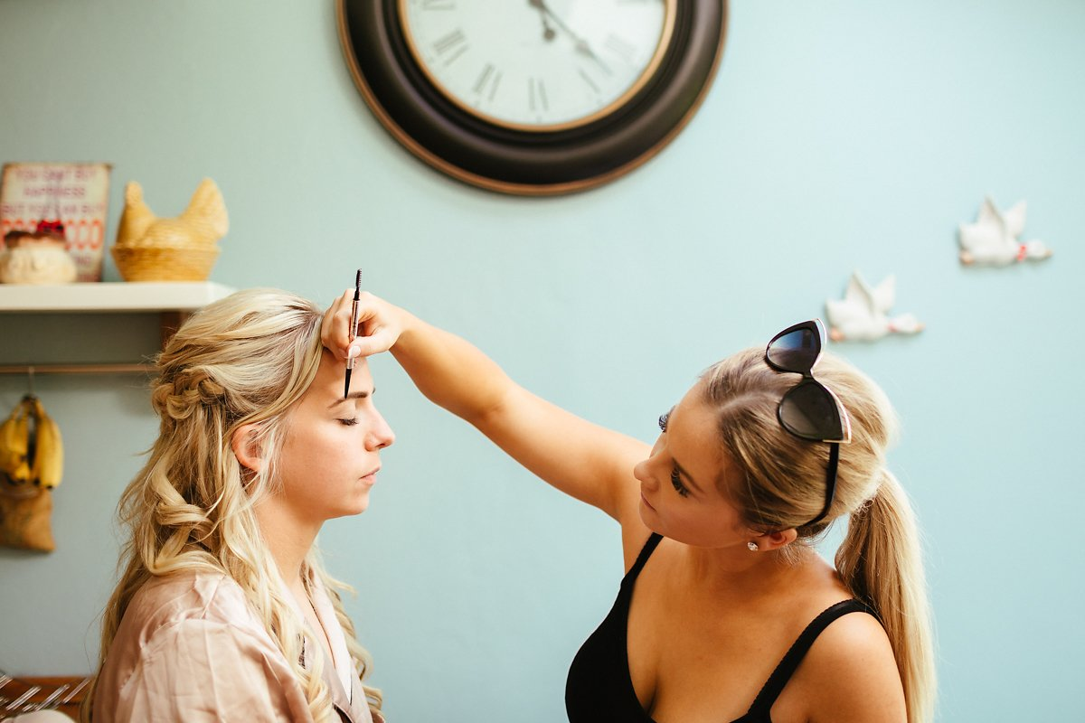 Bride getting ready with bridesmaids at home