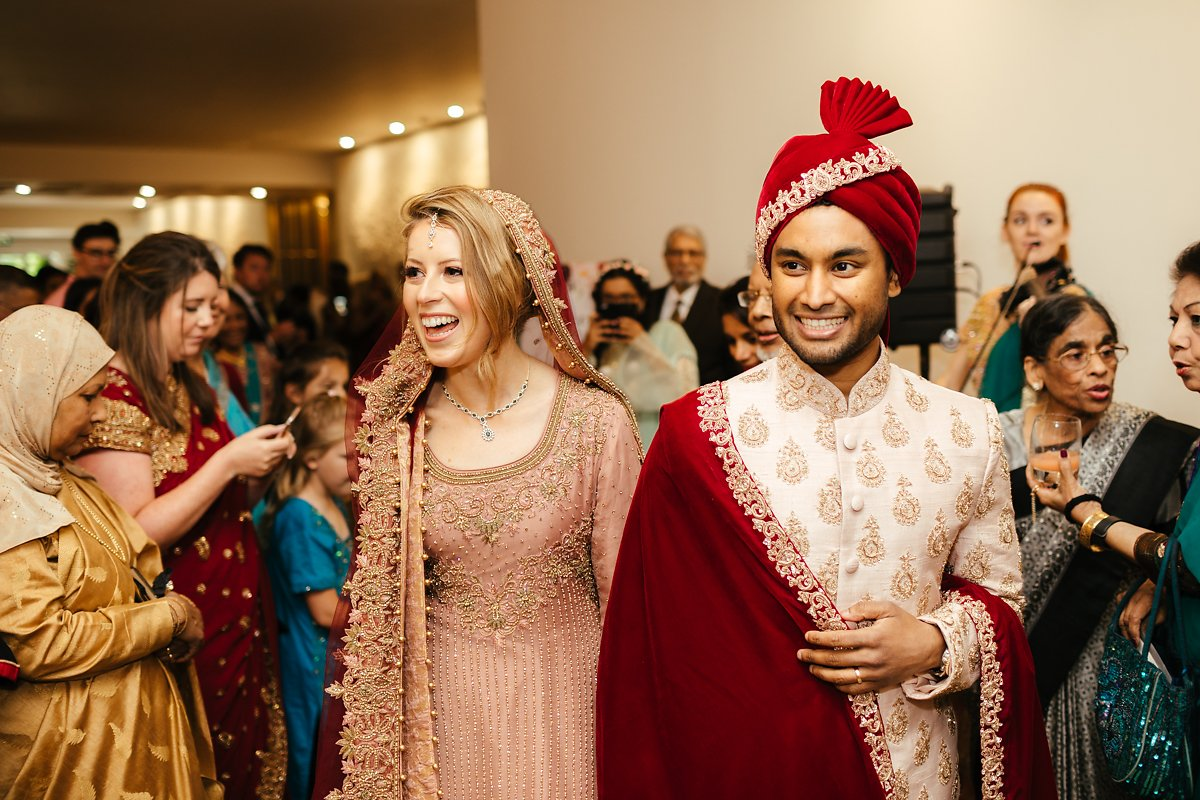 Arrival of bride and groom at Indian wedding photo