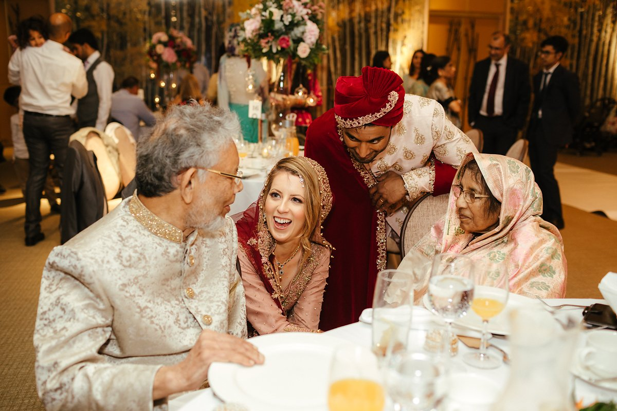Bride and groom greeting the grandparents at Indian wedding