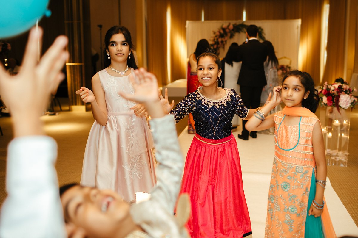 Kids having fun at Indian wedding