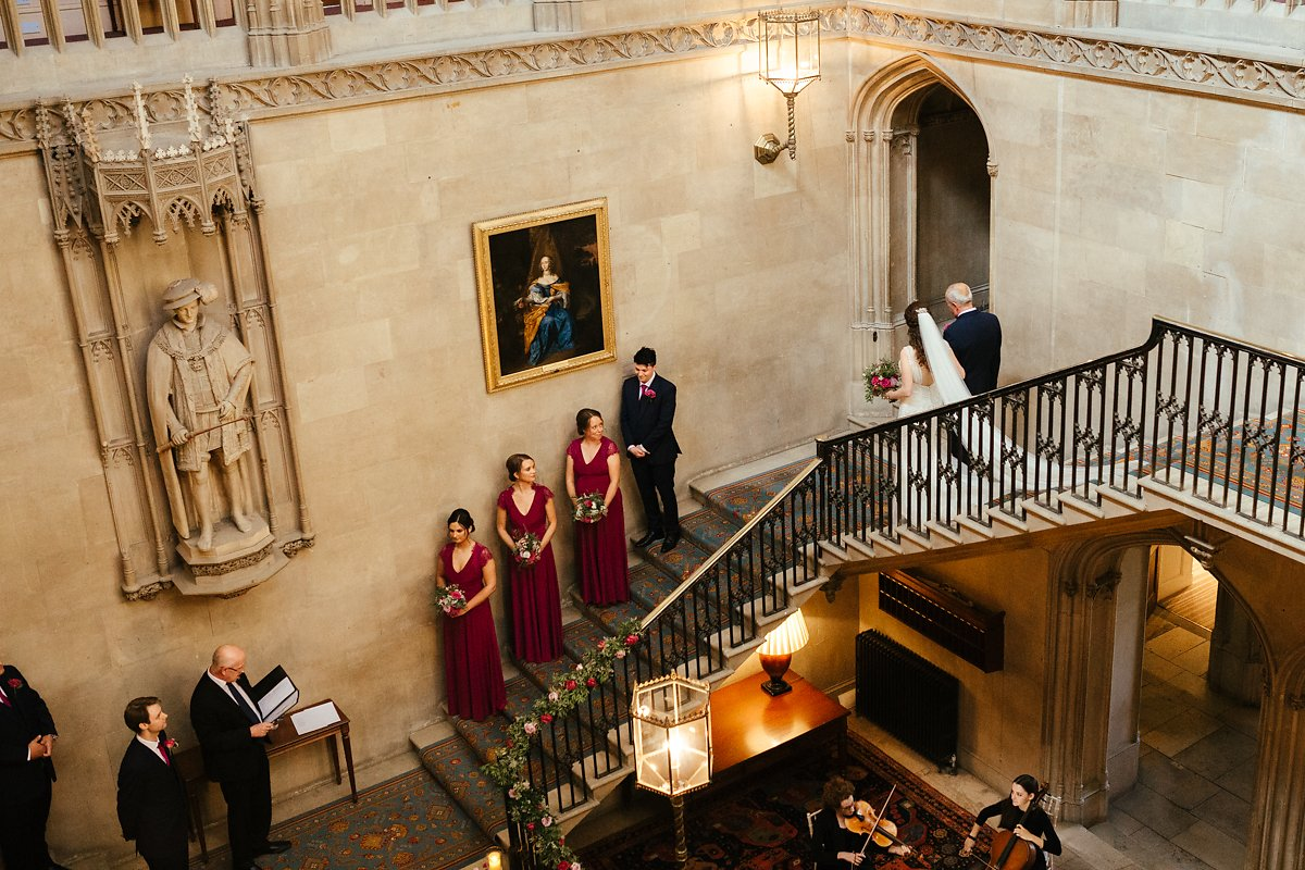 Wedding ceremony at the grand stairs at Ashridge House