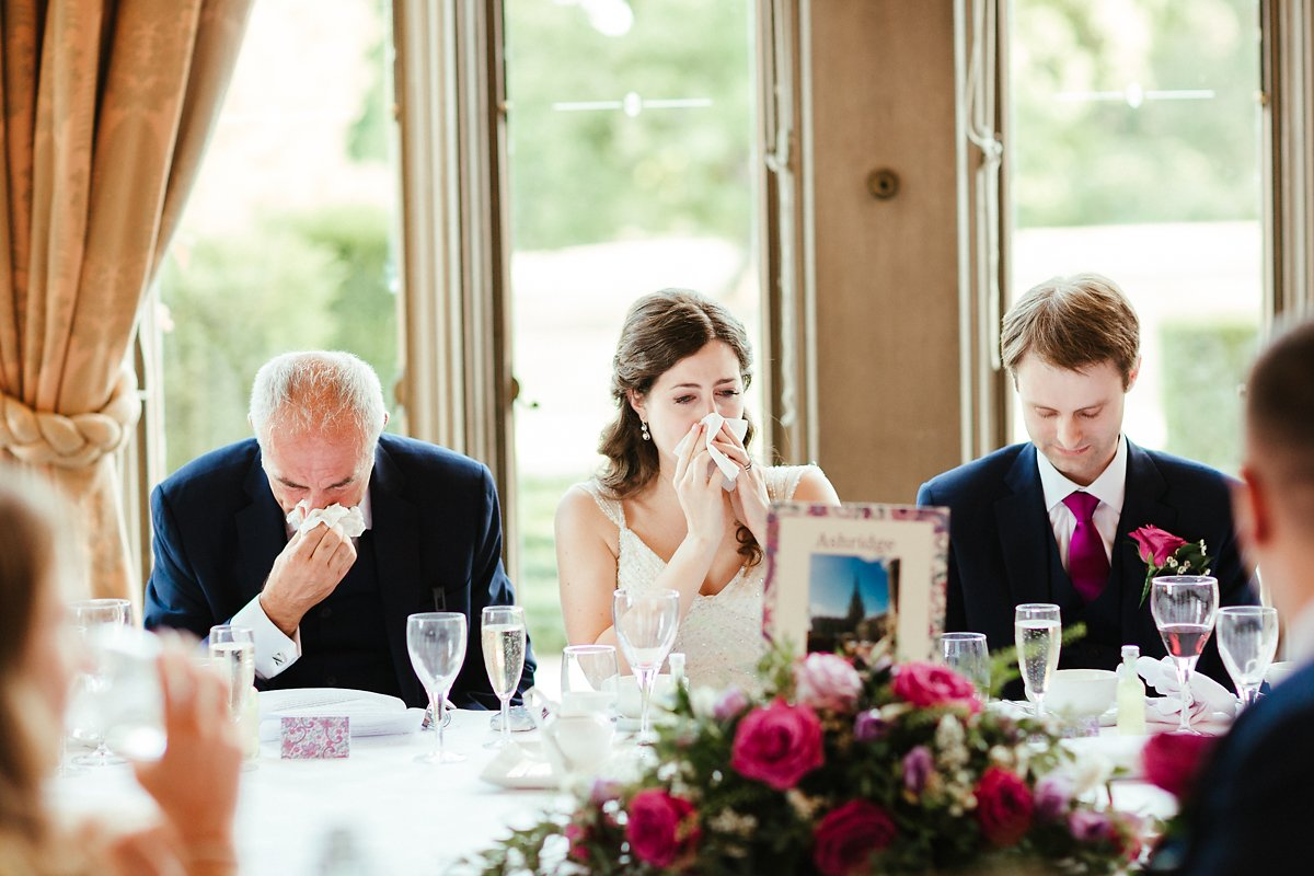 Bride and dad in tears during speeches photo