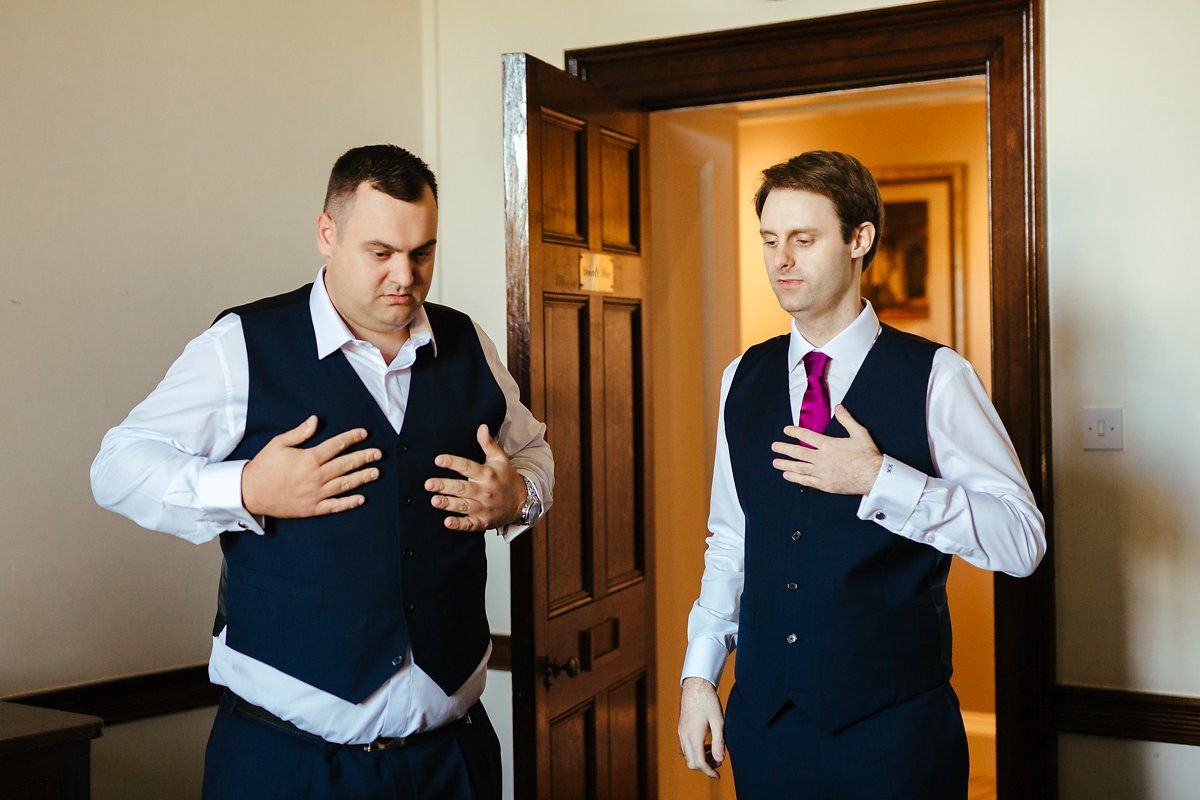 Groom getting ready with his brother at a country house