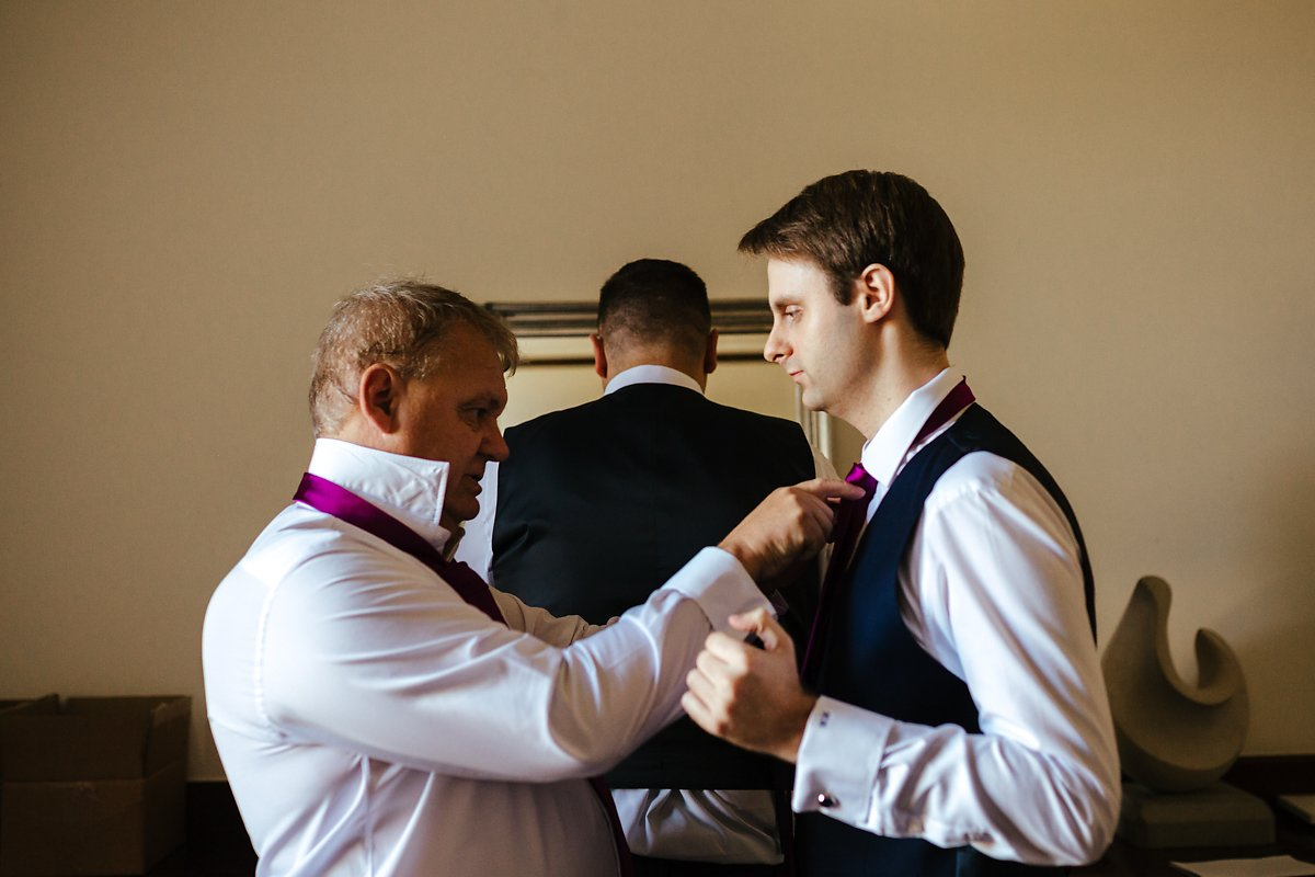 Groom getting ready with his dad at a country house
