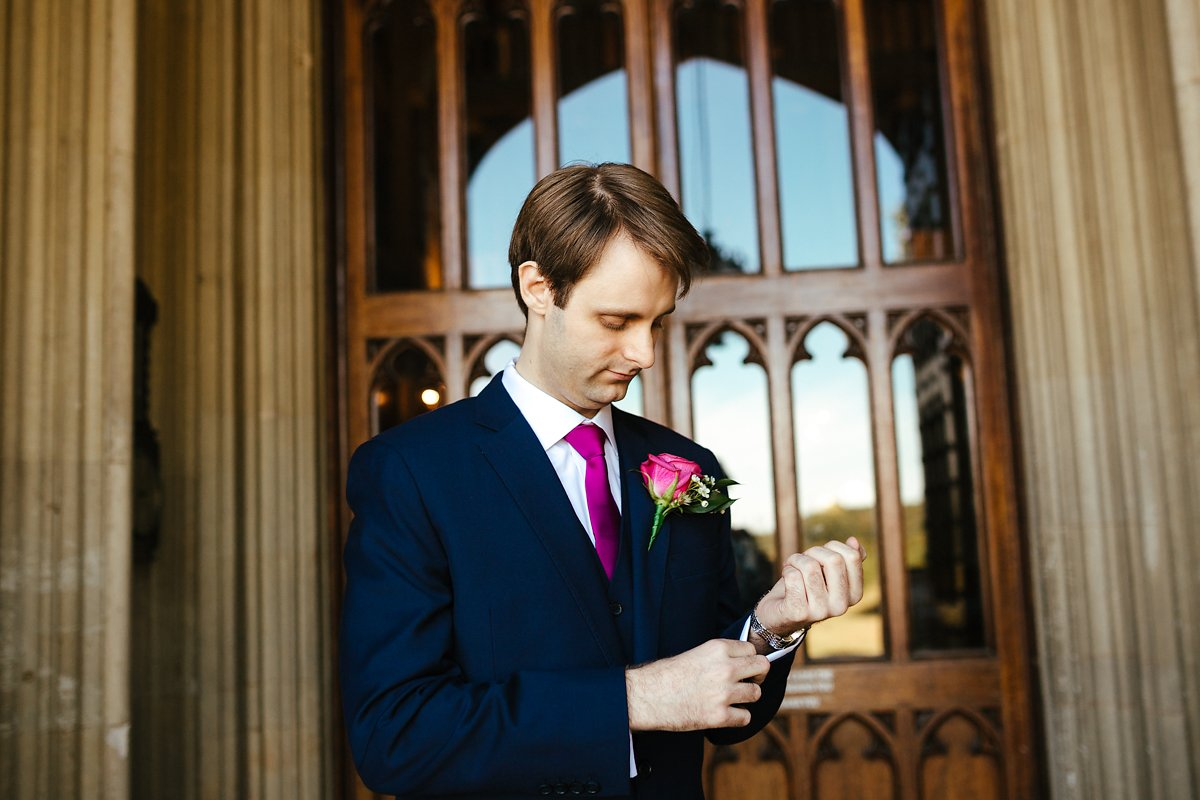 Groom in front of the Ashridge House