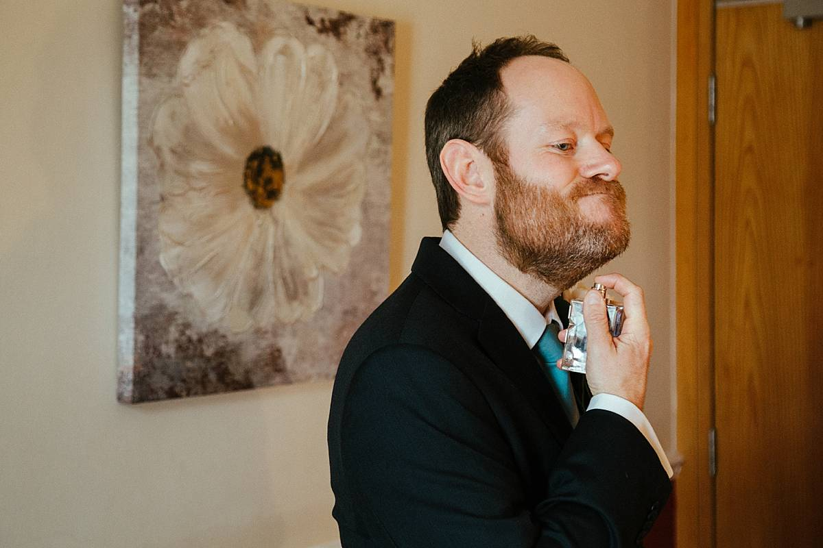Groom getting ready at Missenden Abbey